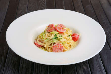 pasta with cheese and tomato Imagens