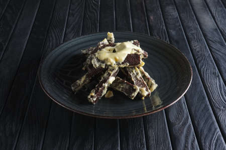 Brown bread cracker with melted cheese