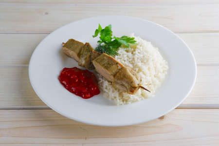 Pork shaslyk with rice and tomato sauce