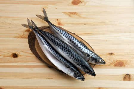 Frozen mackerel on wooden table