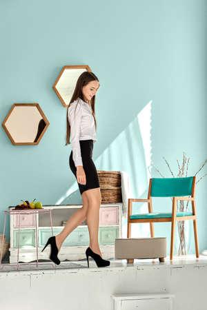 Pretty girl in black skirt and white shirt Imagens