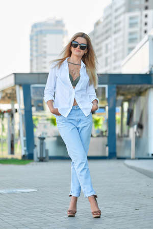 Pretty girl posing on street near office building Imagens