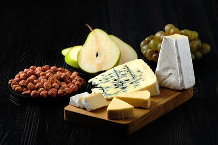 Low key photo of assortment of cheese and snack for wine Stock fotó - 136741077