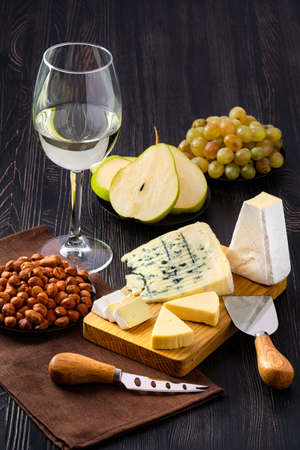 Snack for wine - sheese plate and fruits Stock fotó