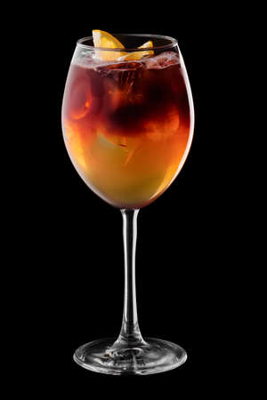 Espresso and tonic cocktail in wine glass isolated on black background