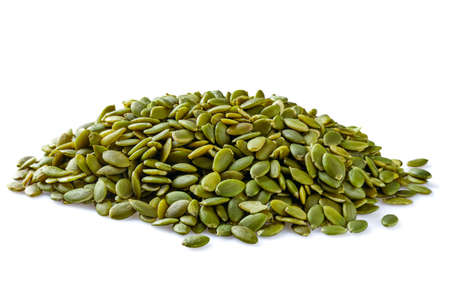 Heap of peeled pumpkin seeds isolated on white