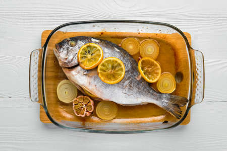 Overhead view of gilt head bream baked in oven
