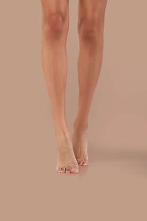 Front view of bare legs of african girl model