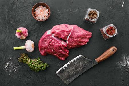 Raw fresh beef chuck eye roast on black background