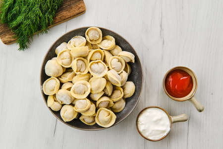 Top view of homemede meat dumplings on white wooden table