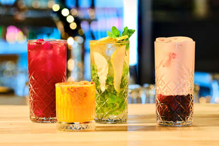 Classic cold cocktails - rum and cola, mojito and clover club (soft focus photo with shallow depth of field) Imagens