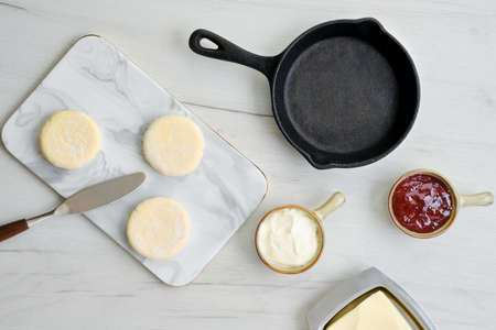 Top view of fresh cottage cheese pancake on marble serving board