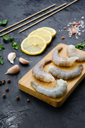 Composition with fresh raw prawn with spice and herbs Standard-Bild