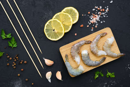 Overhead composition with fresh raw prawn with spice and herbs