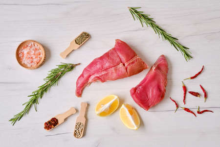 Raw fresh pieces of tuna fillet with spice