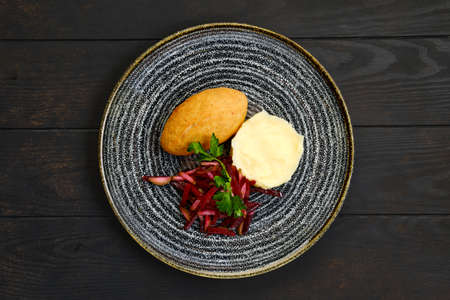Top view of chicken cutlet stuffed with cheese served with millet porridge and pickled cabbage