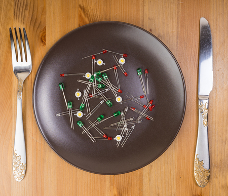 leds: Abstract idea of technology as food, leds on the plate Foto de archivo