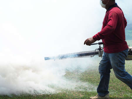 Men are working fogging to eliminate mosquitoes.