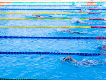 Young women swimmers on competition.