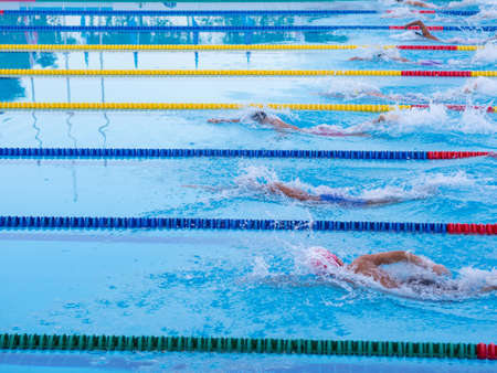 Young men swimmers on competition.