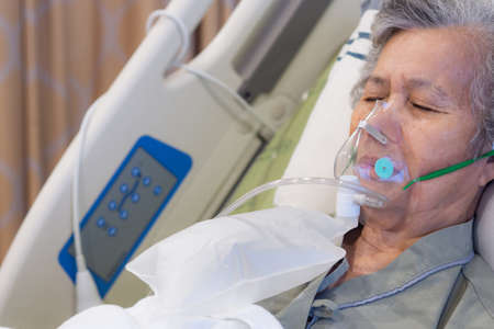 Close-up of elderly woman patients with lung disease, getting oxygen for treatment in the room at hospital. Space for text. Health care concept