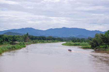 Boat on the Rim Kok River in Chiang Rai, Thailand. Landscape beautiful of nature. Space for text