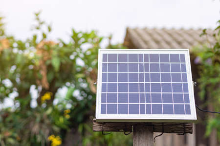 Small size solar cells panels in the garden. Installation photovoltaic for provide light at night. Space for text