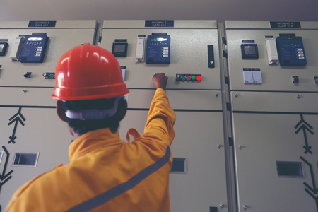 engineer working on checking and maintenance equipment : Switchgear controller to transmission line
