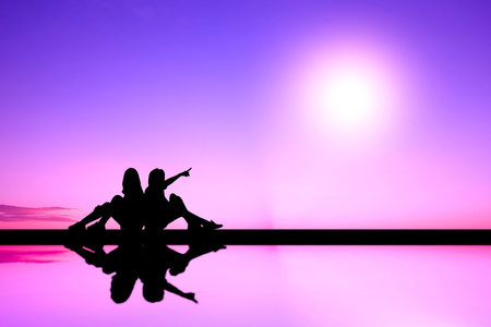 two women sitting back to back. silhouette : purple mood.