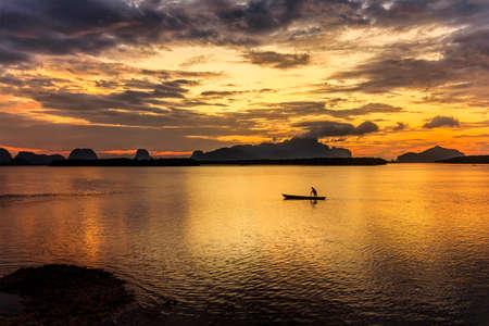 gondola and sunrise at fishing village Samchong-tai Phang-nga thailand Stock Photo