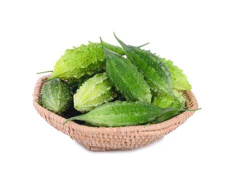 balsam: fresh balsam apple, balsam pear, bitter cucumber, bitter gourd, bitter melon in wooden basket isolated on white