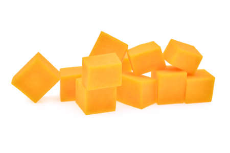 butternut: fresh butternut squash cubes isolated on white background