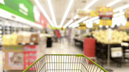 cart in blurred supermarket or department store, shopping concept Archivio Fotografico