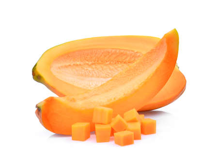 adn: half adn slice of fresh papaya with cubes isolated on white background