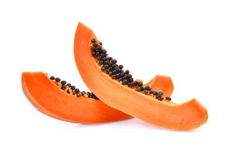sliced of ripe papaya with seeds isolated on white background