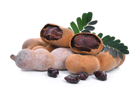 tamarind with leaf and seeds, tropical fruit isolated on white background
