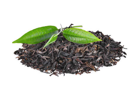 pile of dried green tea with fresh green tea leaves isolated on white background