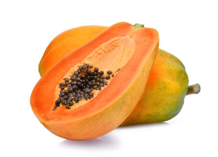 whole and half of ripe papaya fruit with seeds isolated on white background Archivio Fotografico