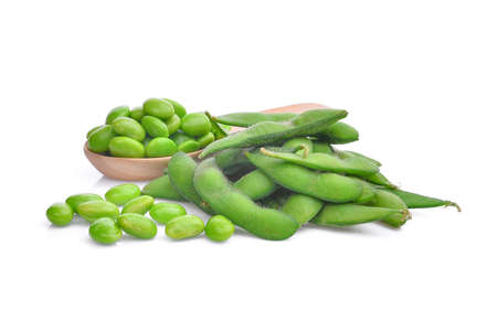 edamame green beans in wooden spoon isolated on white background
