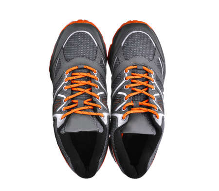 top view of new unbranded sport shoes isolated on white background