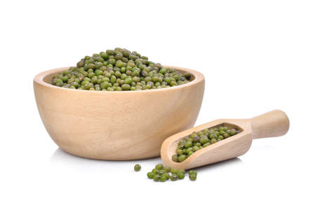 mung beans in wooden scoop and wooden bowl isolated on white background