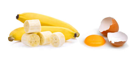 banana skin: ripe bananas with slice and eggs isolated on white background Stock Photo