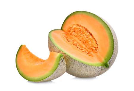 日本のメロン、オレンジ色のメロンや白い背景で隔離の種メロンのスライスと全体 写真素材