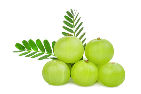 pile of indian gooseberry fruit with green leaves isolated on white background