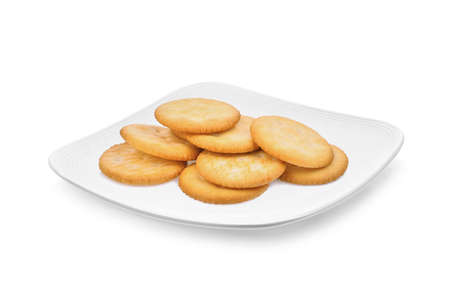 biscuit crackers in the white plate isolated on white background