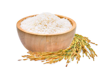 white rice (Thai Jasmine rice) in the wooden bowl and unmilled rice isolated on white background Stock Photo