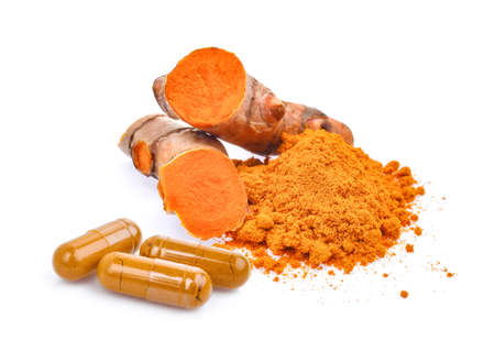 turmeric root and powder with turmeric capsules isolated on white background