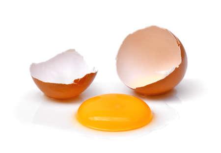cracked egg with egg shell, egg yolk and egg white isolated on white background