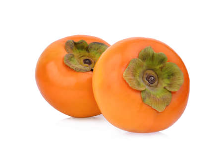 two whole ripe persimmons isolated on white background