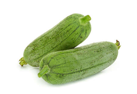 fresh green sponge gourd or luffa isolated on white background